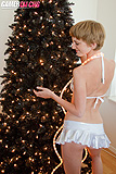 Josephine Nude Against Black Christmas Tree