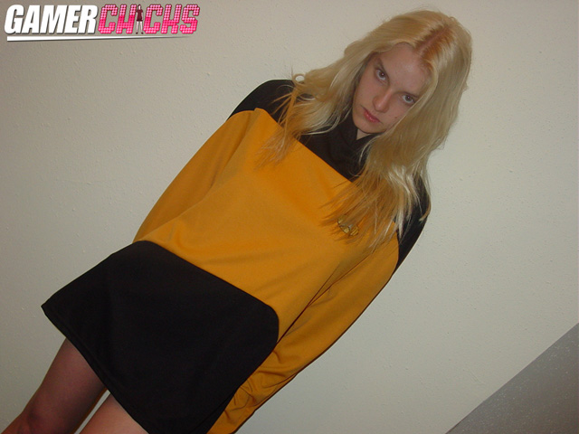 We love to dress up girls in Star Trek costumes. It was no where near Halloween when Liz Ashley put this on. There's something about a gorgeous blonde in uniform. This beautiful vixen really loves to tease!